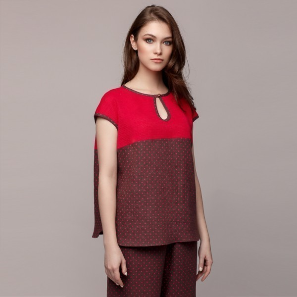 Linen dot printed fabric top with linen knit inserts.